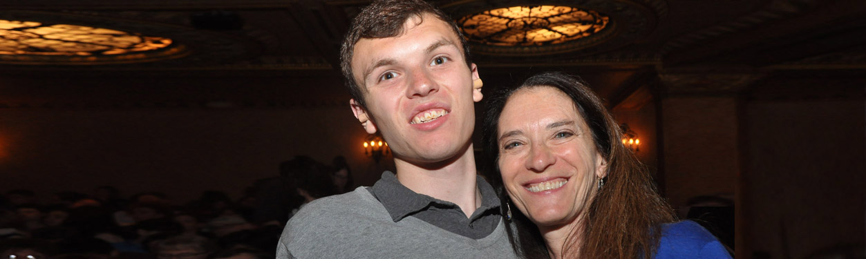 A mother and son attend an autism friendly performance