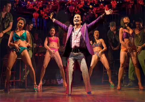 Jon Jon Briones (center) and the cast of