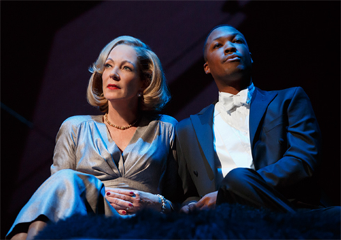 Allison Janney (as Ouisa) and Corey Hawkins (as Paul)