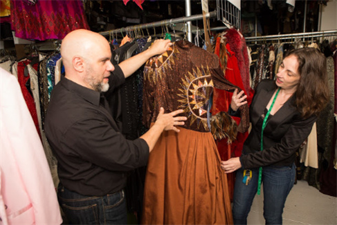 Stephen Cabral helping a TDF Costume Collection Rental Program client