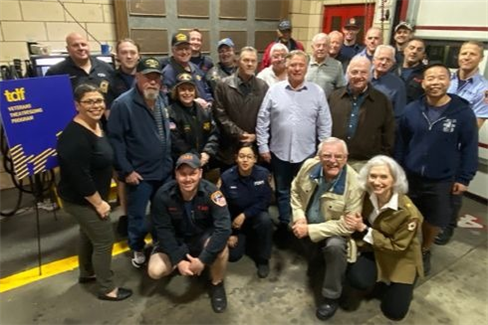 Veterans at a firehouse before a TDF matinee, with Program Coordinator Vicki Bello on the left, and Director of TDF Accessibility Programs Lisa Carling on the right
